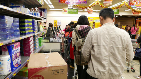 POV standing in queue, grocery shop, cashiers in front, chinese shop Footage