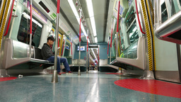 One man in empty metro train, moving in the night. Low angle view from floor Footage