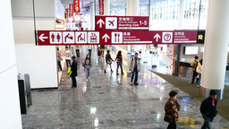 International airport directory signboard in motion, against duty free zone Footage