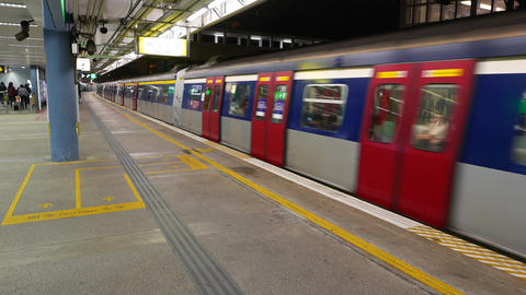 Train departs from platform, repeating alert sound, car move away Footage