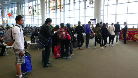 Boarding gate queue, people stand in line, slowly move to gate, parallax shot Footage
