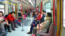 Inside MTR train, passengers sitting, not overcrowded, carriage interior Footage