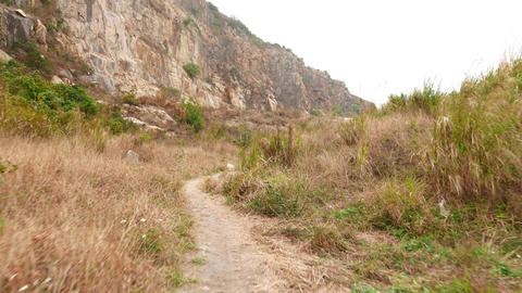 Walk on deserted rocky mountain foot, former stone quarry at Lei Yue Mun shore Footage