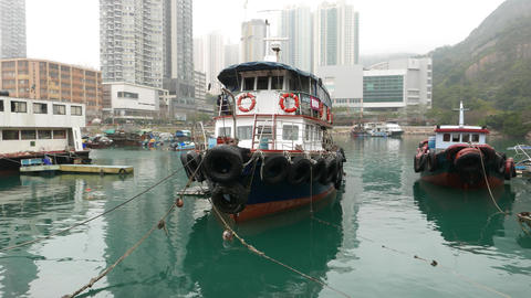 Authentic passenger vessel against cityscape, calm waters, beautiful view Footage