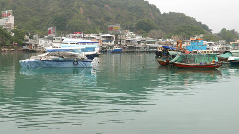 Boats on beautiful colored waters of typhoon shelter in Lei Yue Mun Footage
