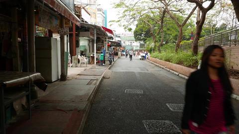 Walking Lei Yue Mun Praya Road, entrance to fisher village, market restaurants Footage