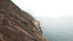 Devil's peak rocky shore, misty crag landscape against foggy horizon Footage
