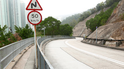 Mountain road turn, speed sign and warning, bus drive down the serpentine Footage