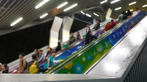 Blurred anonymous people travelling on escalator, up and down, perspective Footage