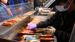 Hot grill for sausages on wood stick - fresh market fast-food Footage