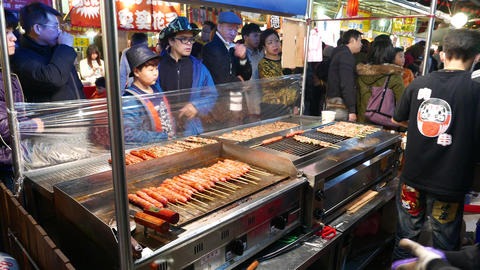 General view on barbecue eatery on night taiwanese market Footage