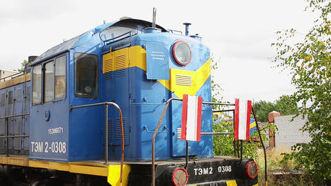Abandoned bright vintage cabin of engine driver stays on a ground in the depot Footage