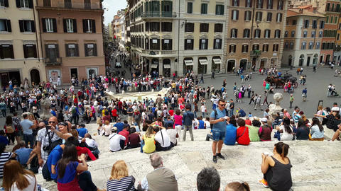 People sitting on Spanish steps from Piazza di Spagna Live Action