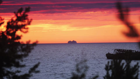 Beautiful summer sea red sunset from hill. One ship on water. Nobody Live Action