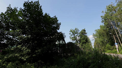 View of countryside with green trees and mansion. Summer. Pan horizontal. Nobody Live Action