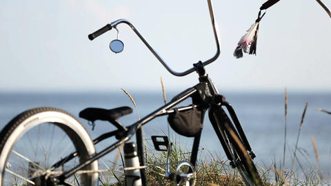 Bicycles stay on hill focus in out, calm sea on background . Summer day. Nobody Live Action