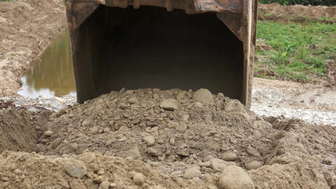 Close-up of an Excavator Bucket Digging in the Dirt Stock Video Footage