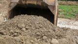 Close-up of an Excavator Bucket Digging in the Dirt Footage