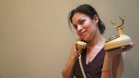 Woman on an Old Retro Style Telephone Stock Video Footage