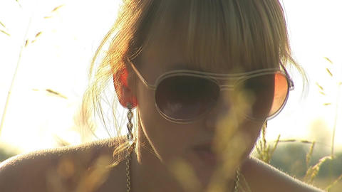 woman in grass d Stock Video Footage