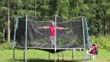 Woman jumping on a trampoline Footage