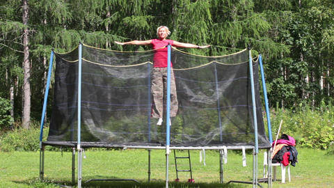 Woman jumping on a trampoline Live Action