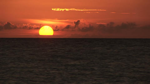 The sun sinking into the sea Stock Video Footage