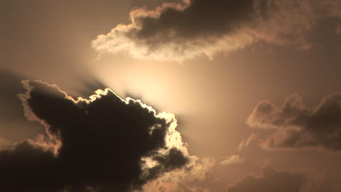 The sun peeking through the clouds Stock Video Footage