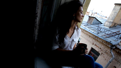 Beautiful woman at a window slider Stock Video Footage