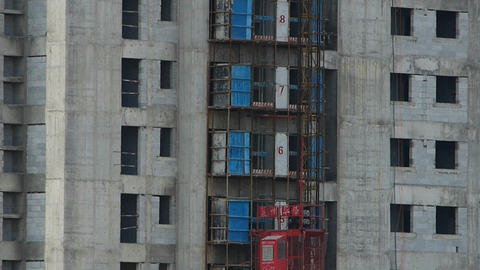 The movement of elevator,close to construction site building Footage