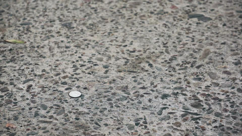 Finding a Lost Quarter on the Street Stock Video Footage