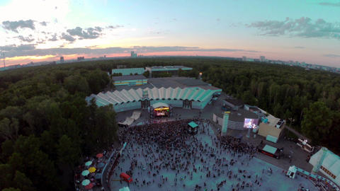 Quadrocopter shoot audience on festival. Evening. Skate park, stage. Zoom in Footage
