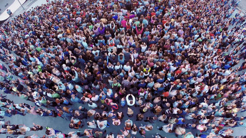 Quadrocopter shoot crowd of people on festival. Applouds. Summer evening Footage