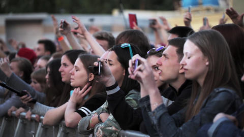 Audience watch on stage, dance, shoot on diferent gadgets. Summer live festival Footage
