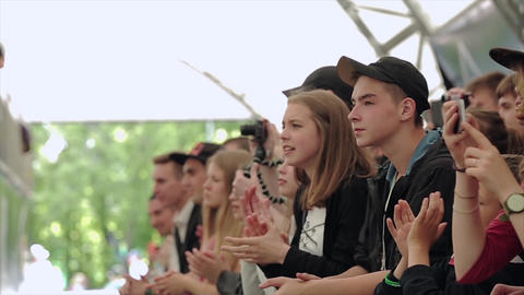 Audience cheering, apploud, shoot on camera. Summer festival. Slow motion Live Action