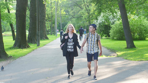 Walking on camera in love couple with backpack. Summer. Holding hands. Happyness Footage