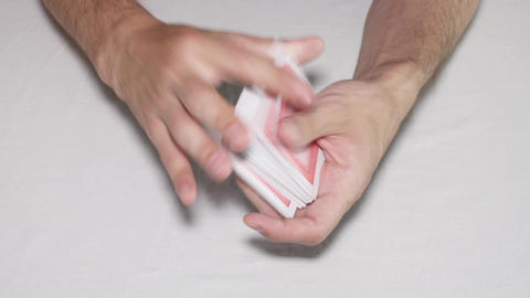 Shuffling playing cards on white background Footage