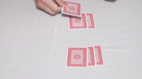 Hands shuffling deck of cards and dealing Footage