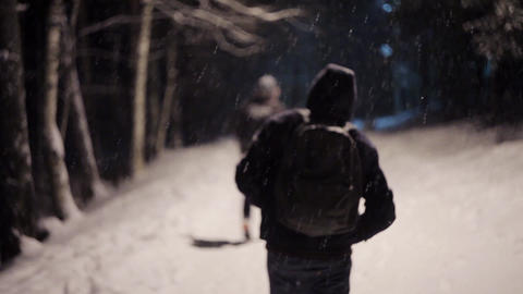 Man walks down the street during a snowy weather Footage
