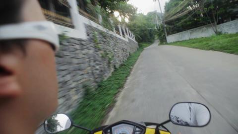 KOH SAMUI, THAILAND - NOVEMBER 9, 2014: Rider on scooter riding Footage