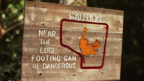 Wooden warning sign edge footing can be dangerous Footage