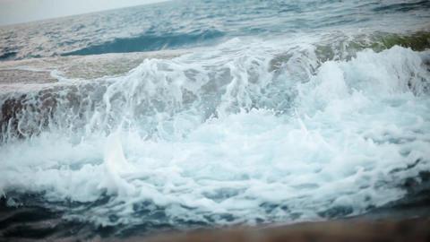 Waves and foam on rocky beach. Breakwater in ocean Footage