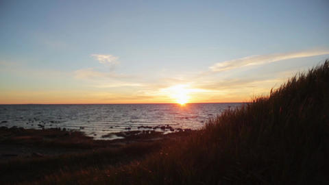 Beautiful summer sea sunset from hill. Sparkling sun beams. Nobody Live Action