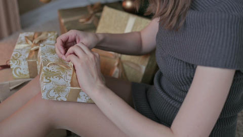Happy young woman opening Christmas present box Footage