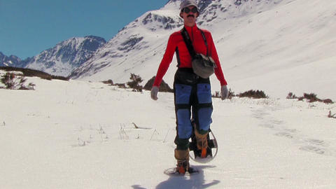 Climber with snowshoes Live Action