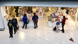 Bookstore in airport. Passengers walking, looking the books Footage