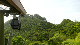 Black VIP private gondola departs from middle station, Langkawi SkyCab Live Action
