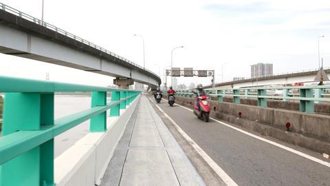 Narrow pedestrian sidewalk at bridge, one way motorbike line ahead Footage