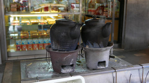 Two black ceramic teapot with boiling water, Traditional tea Footage