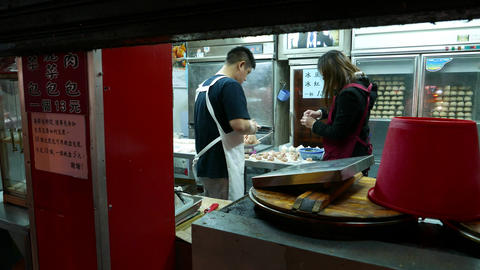 Two make hand made mantou (dumplings) at night restaurant Footage